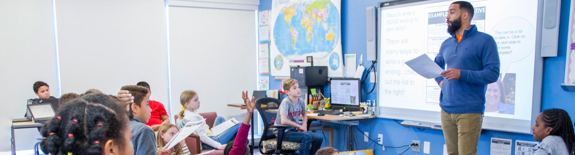 Male teacher teaching in a classroom